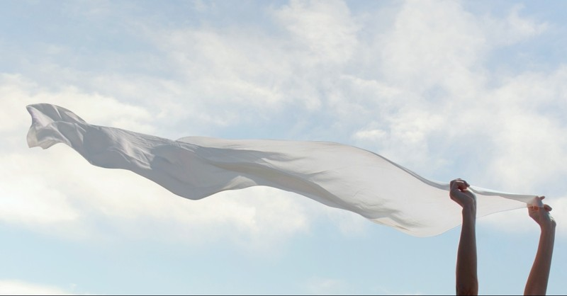 A white veil blowing in the wind