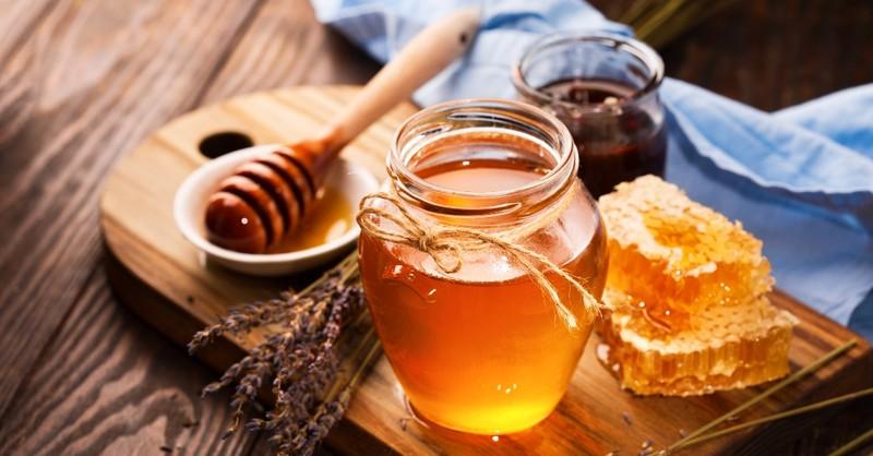Honey jar, comb, flowers
