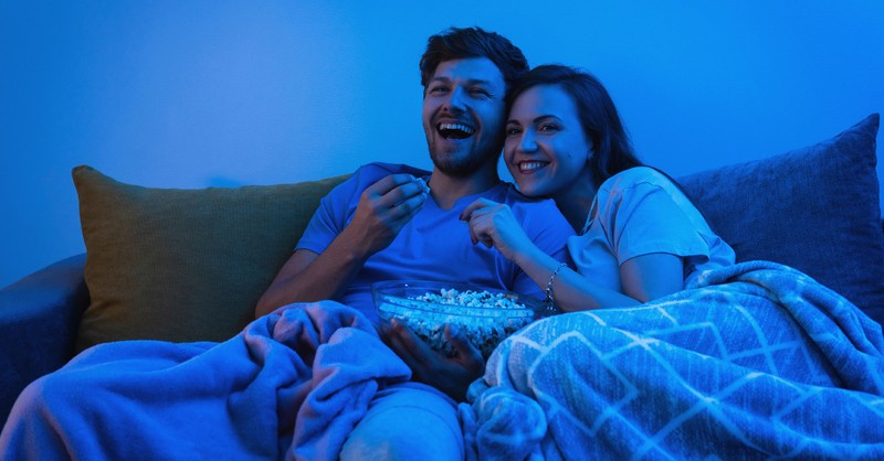 couple on couch watching a movie