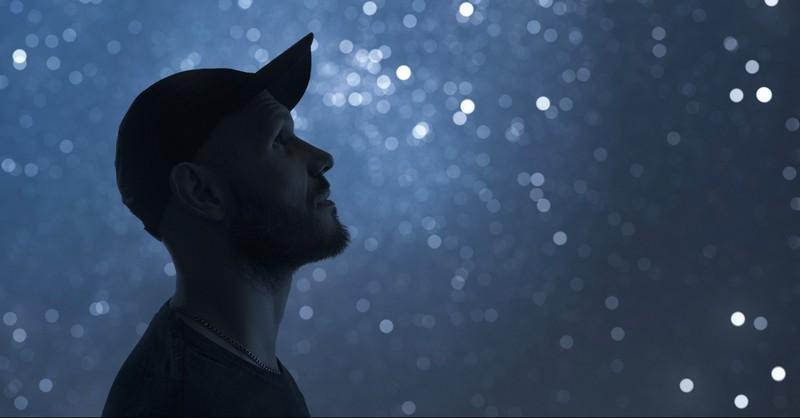 Man looking up at the stars
