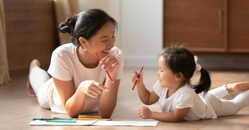 Mother coloring with her daughter