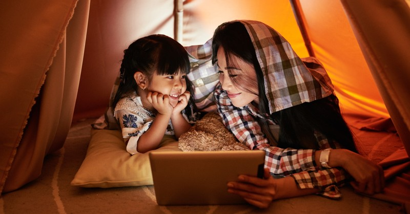 Mom and daughter watching a movie on a tablet, Faith-based movies free on Amazon Prime