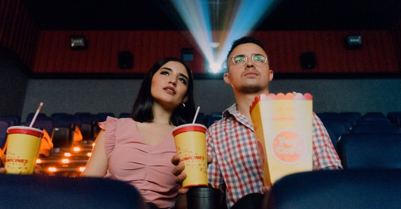 A man and a woman watching a movie in a theater, movies you should watch this summer