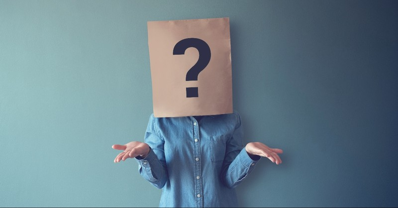 Woman with a question mark in front of her face