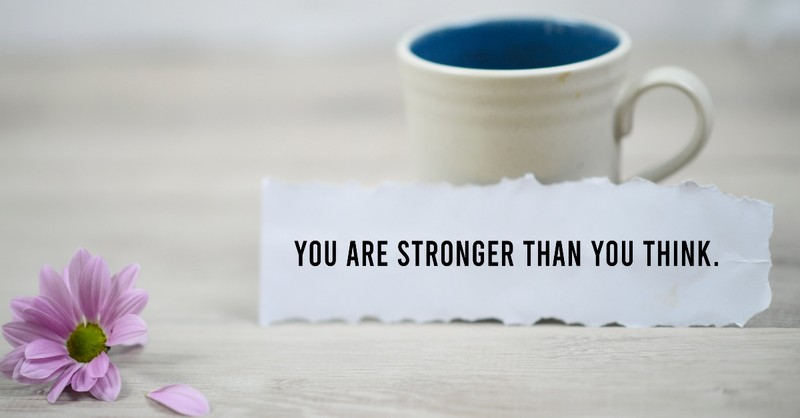 Mug and flower with a note saying you are strong than you think
