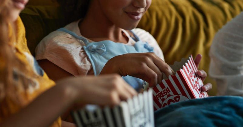 Kids eating movie popcorn, Movies and shows streaming this summer