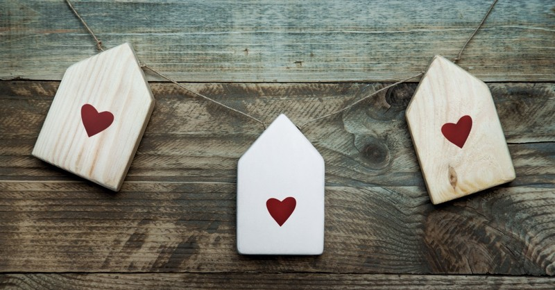 Three houses with hearts