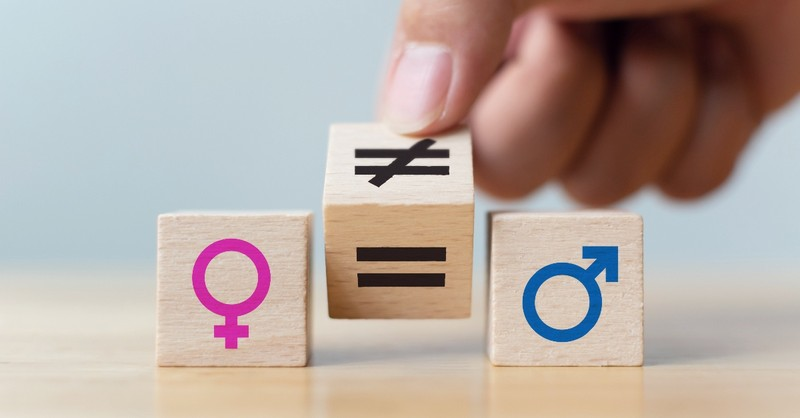 Female and male symbols on blocks with an equal to not equal block