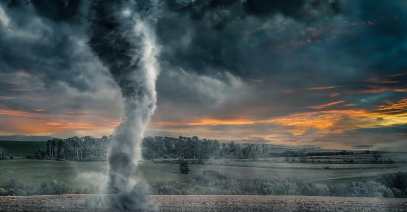 Tornado blowing through a field