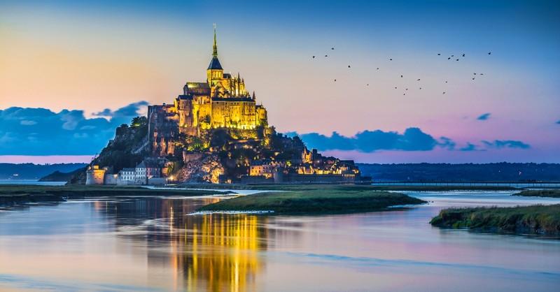 Mont Saint-Michel in twilight at dusk, Normandy, France