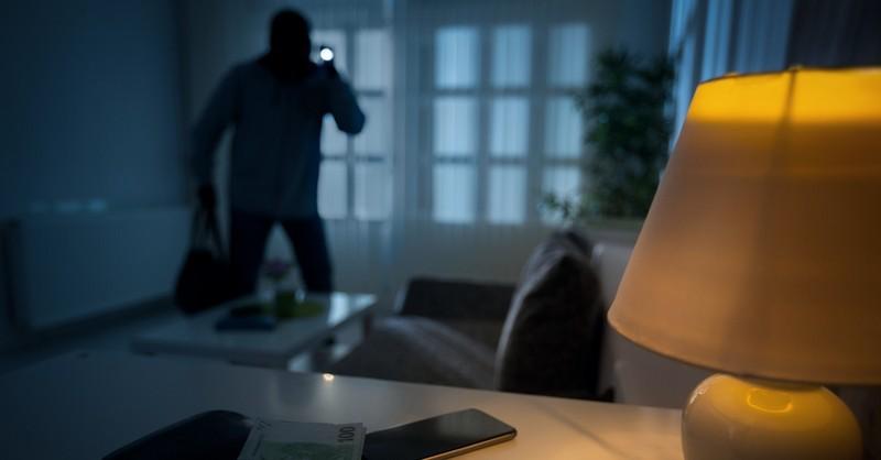A thief robbing a house