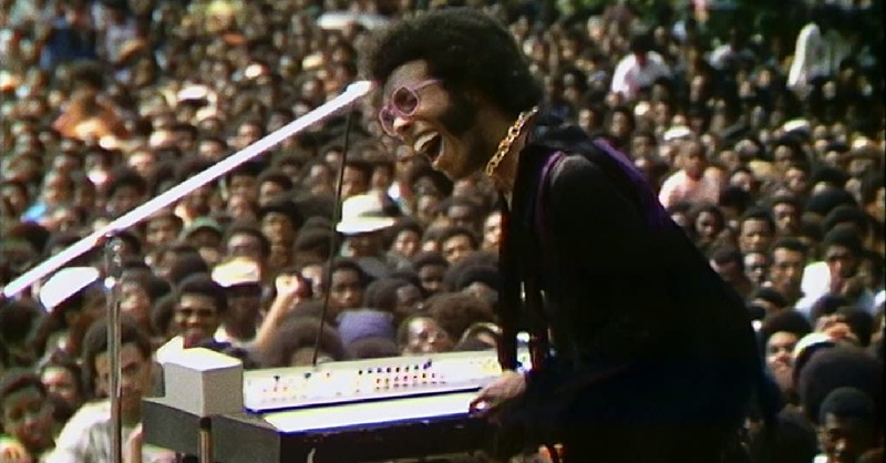 """Sly Stone performing at the Harlem Cultural Festival, Things to Know about the Musical Documentary """"Summer of Soul"""""""