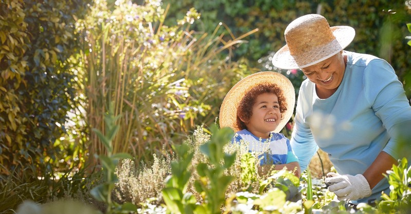 A grandmother and grandson gardening