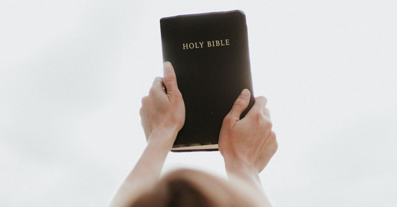 holding up bible above head bible thumper holy bible