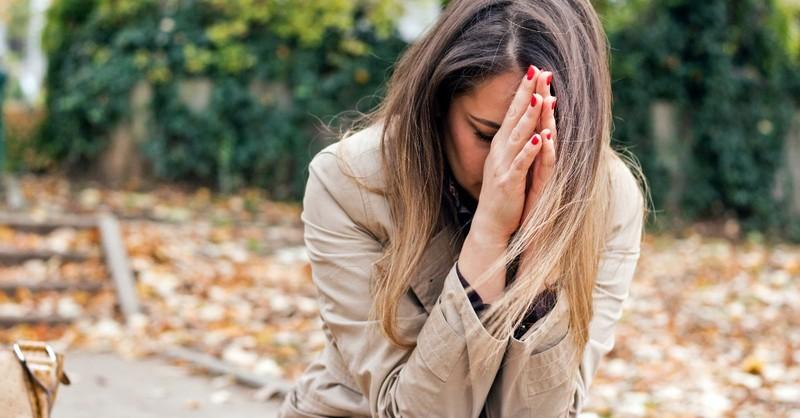 Woman desperately praying
