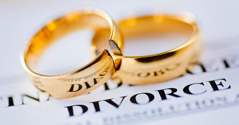 Broken wedding rings on divorce papers