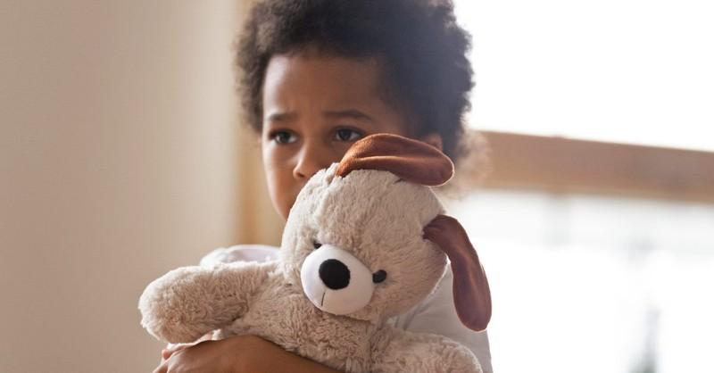 Scared little boy with a teddy bear