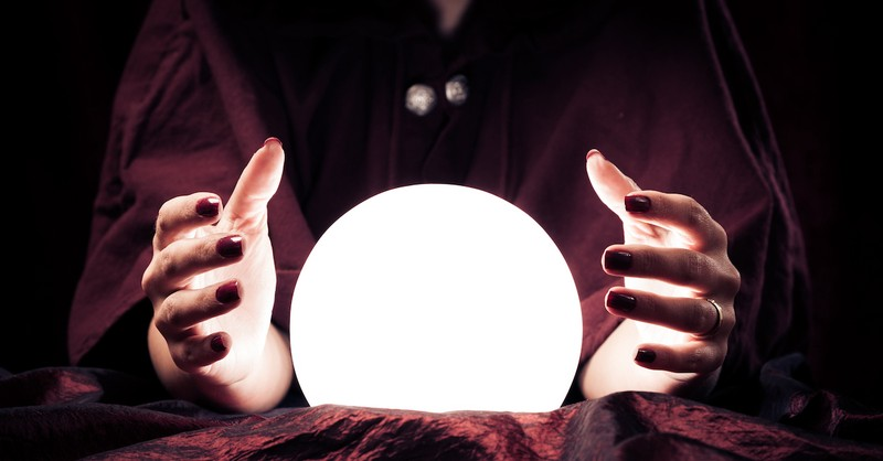 hands around a crystal ball, what does the Bible say about mediums