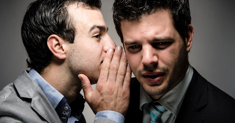 business man whispering into another business man's ear looking secretive and worried, bless is he who does not walk in counsel of wicked