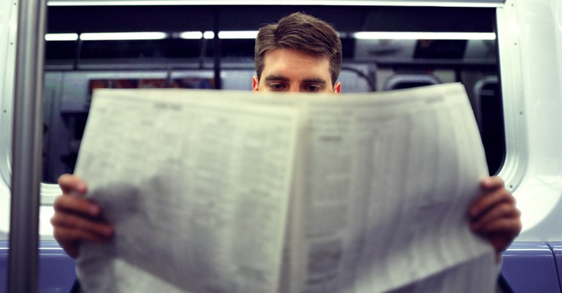 A man reading a newspaper, poll finds that just 35 percent of Republicans trust the national media