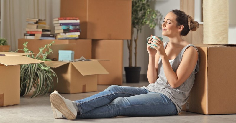 Woman moving into a new home