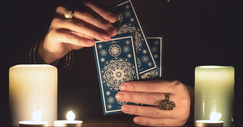 Woman holding tarot cards