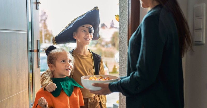 halloween trick or treat handing out candy fall autumn neighbor