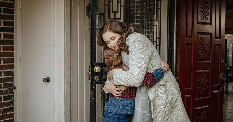 Friends hug at a front door in the new God's Not Dead film