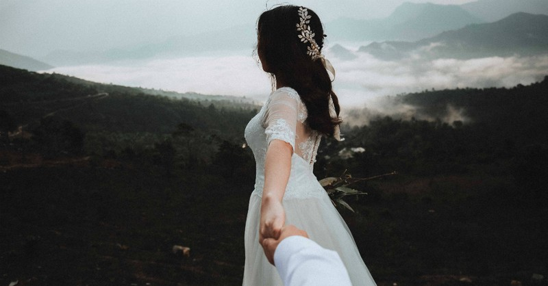 bride holding hand in beautiful nature, what every bride needs to know before marrying