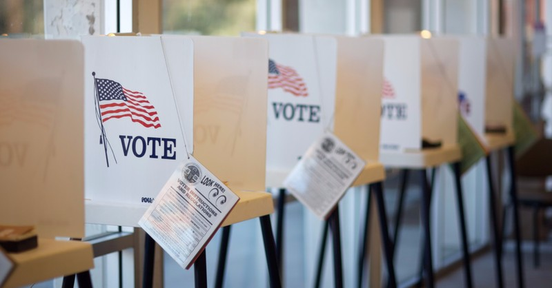 Line of voting booths on election day