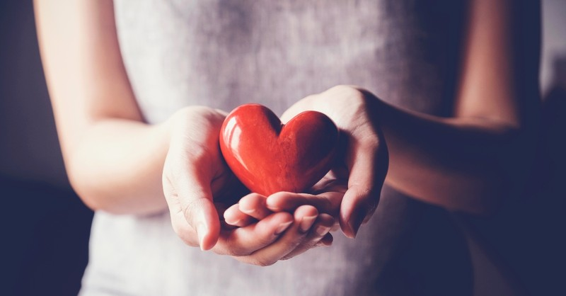 hands holding heart object
