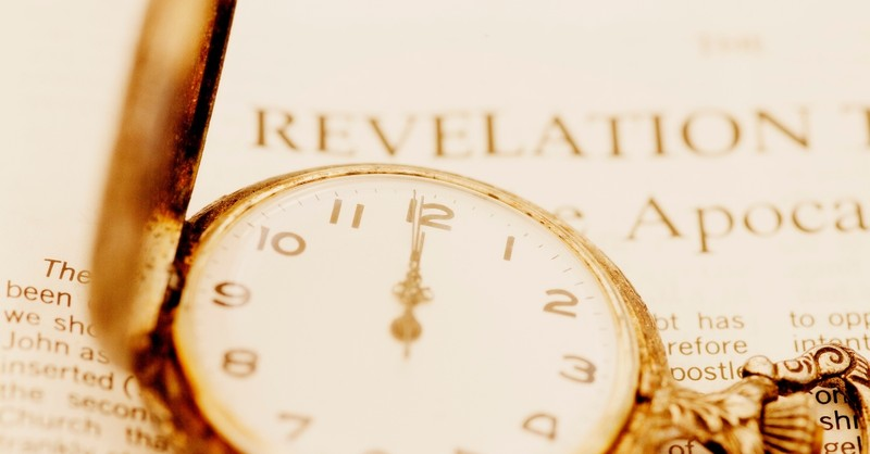bible open to Revelation with clock at 12 - book of Revelation explained