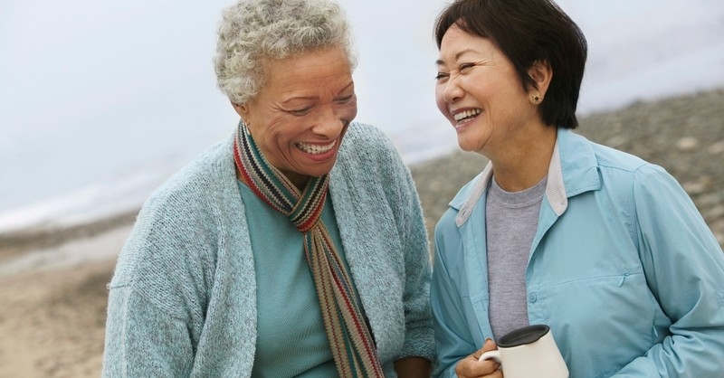 Two senior women laughing together