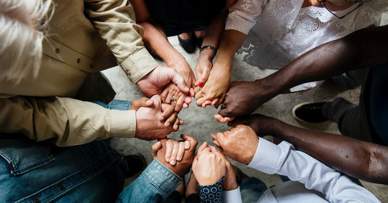 prayer for unity in america, multicultural holding hands