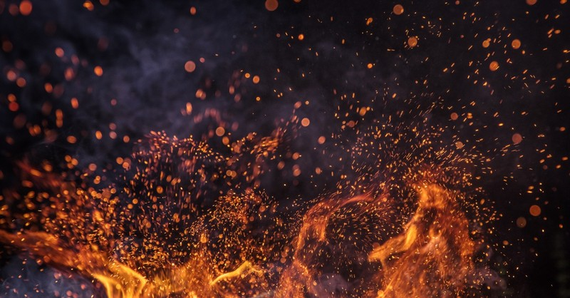 flame fire sparks against dark sky
