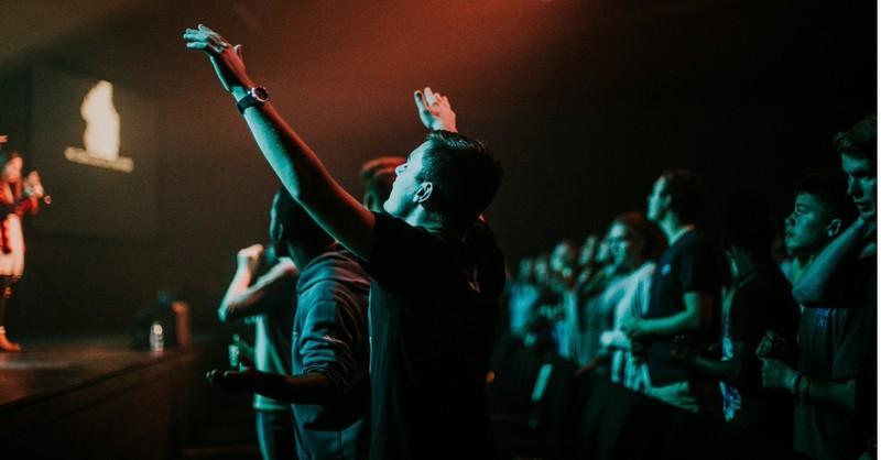 man hands raised worship