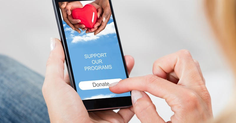 woman donating on cell phone God Loves a Cheerful Giver