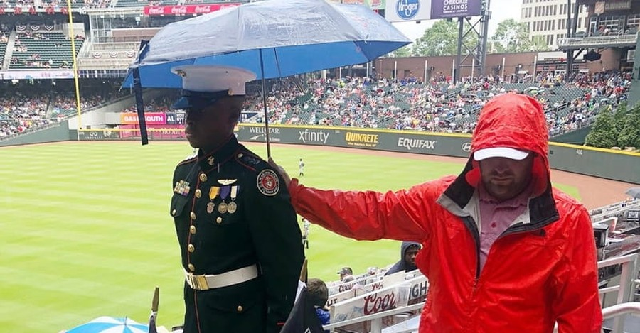 Moving Photo Shows Atlanta Braves Fan Shielding JROTC Member from Rain