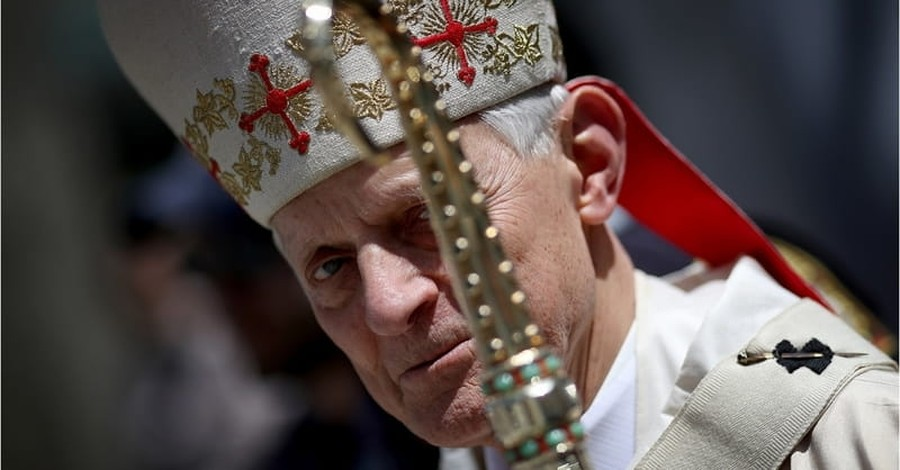 Protester Shouts 'Shame on You' at Archbishop Wuerl during Mass