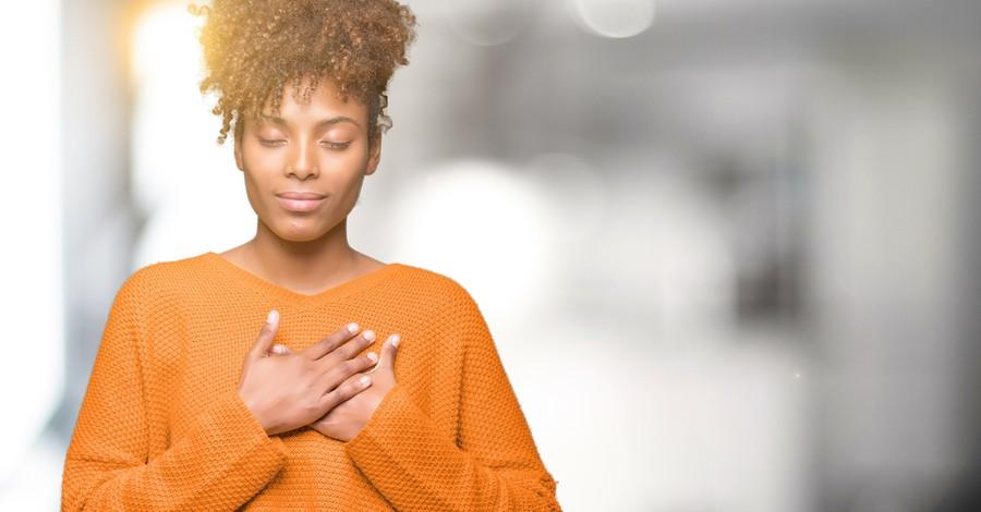 grateful woman praying out of thankfulness