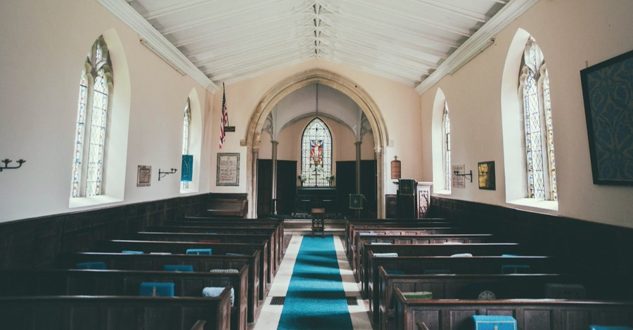 An empty church, church suspends in-person services after families contract COVID-19