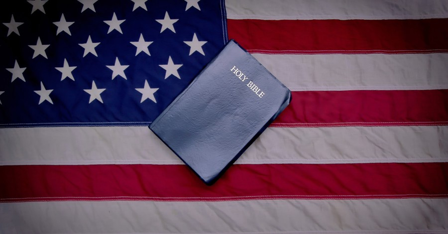 Bible on top of the American flag, America must remember to be a nation under God