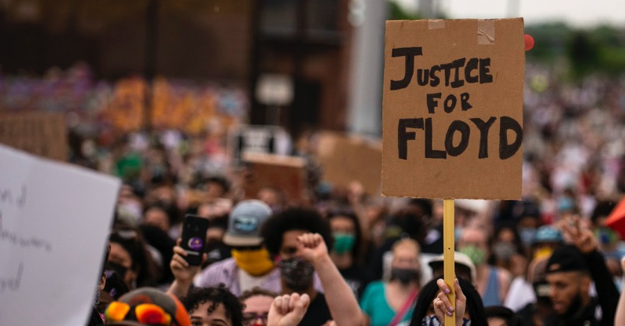 Justice for Floyd sign, Four officers are fired after a black man dies while in custody