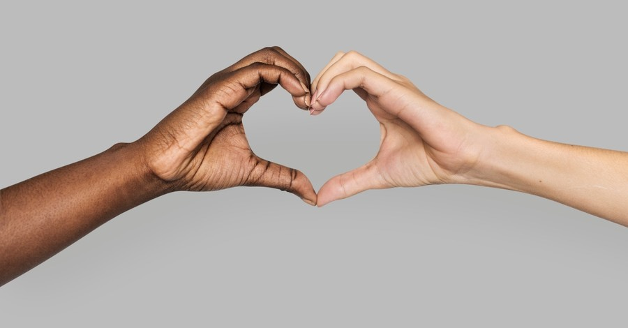 black and white hands making heart shape together, 30 day anti-racist prayer challenge