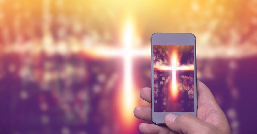 cross image on smartphone social media faith