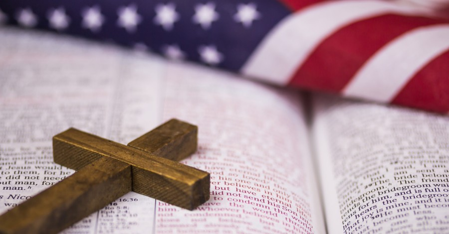 A cross the Bible and the American flag, most practicing Christians think America is blessed by God