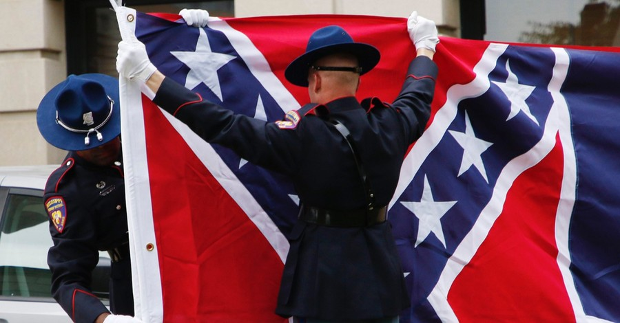 The Mississippi flag, Some question placing the confederate symbol on the Mississippi flag with the phrase 'In God We Trust'