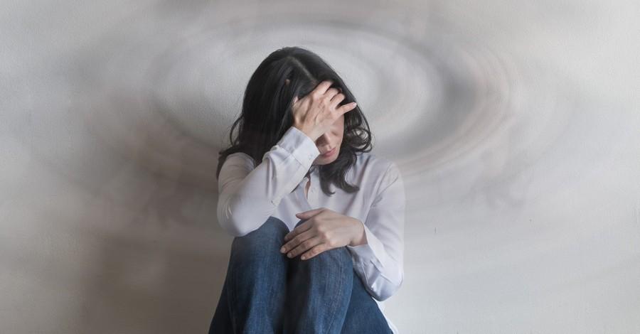 A sad woman sitting on the floor, The universal virus of sin