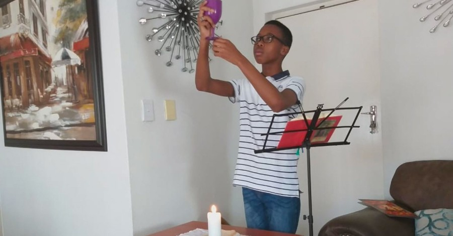 Young boy worshiping in South Africa, How many South Africans are worshiping at home