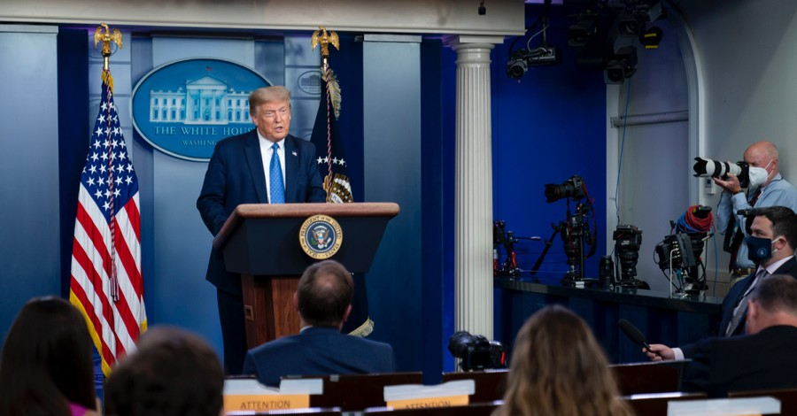 Trump speaking at a press conference, Trump suggests that parents get taxpayer funding if schools choose not to reopen